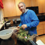 Paul Chatlin preparing food in his kitchen. (Photo Donna Agusti C&G News)