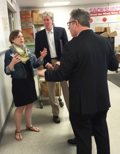 Jenny Jordan explains the logistics of creating 5,500 meals a day to EAG's Kerry Kilpatrick, center, and Scott Ringlein.